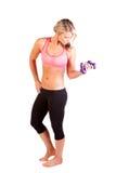 Uma jovem mulher bonita que faz o exercício Imagens de Stock