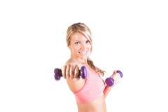Uma jovem mulher bonita que faz o exercício Foto de Stock