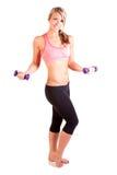 Uma jovem mulher bonita que faz o exercício Imagens de Stock Royalty Free