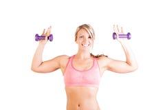 Uma jovem mulher bonita que faz o exercício Fotos de Stock