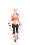 Uma jovem mulher bonita que faz o exercício Foto de Stock Royalty Free