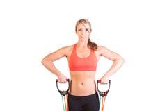 Uma jovem mulher bonita que faz o exercício Imagem de Stock