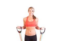Uma jovem mulher bonita que faz o exercício Fotos de Stock Royalty Free