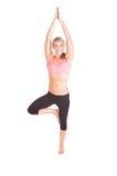 Uma jovem mulher bonita que faz o exercício da ioga Foto de Stock