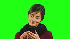 Uma jovem senhora Chatting no telefone imagem de stock royalty free
