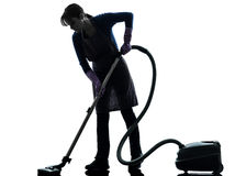 Silhueta do aspirador de p30 dos trabalhos domésticos da empregada doméstica da mulher Fotografia de Stock Royalty Free