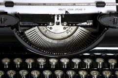 Uma máquina de escrever velha com o texto que ` s seu Stor foto de stock royalty free