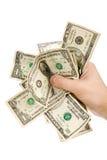 Uma mão completamente de dólares americanos Foto de Stock Royalty Free