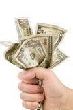 Uma mão completamente de dólares americanos imagem de stock