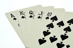 Uma mão de pôquer real dos cartões de jogo do resplendor reto Imagens de Stock Royalty Free