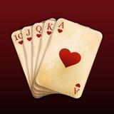 Uma mão de pôquer real dos cartões de jogo do resplendor reto Imagem de Stock Royalty Free