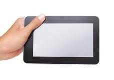 Uma mão do homem que prende uma tabuleta de toque Fotos de Stock