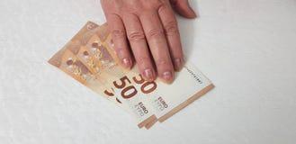 Uma mão fêmea superior no euro 50 imagens de stock royalty free