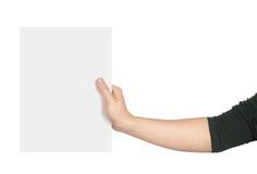 Uma mão que guarda um pedaço de papel Imagem de Stock