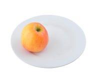 Uma maçã na placa Imagens de Stock