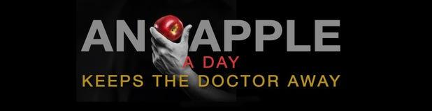 Uma maçã um o dia… Foto de Stock