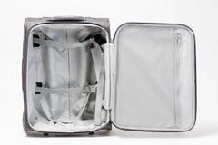 Uma mala de viagem cinzenta aberta e vazia está pronta para uma viagem grande Suitcas Fotos de Stock