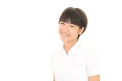 Uma menina adolescente de sorriso Fotos de Stock Royalty Free