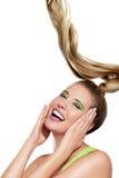Uma menina bonita que mostra o cabelo ventoso longo Fotos de Stock Royalty Free