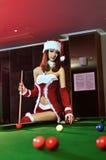 Uma menina chinesa vestida em trajes do Natal Fotografia de Stock Royalty Free