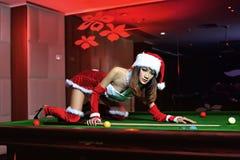 Uma menina chinesa vestida em trajes do Natal Imagem de Stock