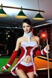 Uma menina chinesa vestida em trajes do Natal Foto de Stock