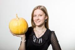 Uma menina com abóbora Imagem de Stock Royalty Free