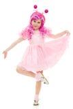Uma menina com cabelo cor-de-rosa em uma dança cor-de-rosa do vestido Fotografia de Stock Royalty Free