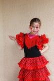 Uma menina com flamenco da dança da composição Fotografia de Stock