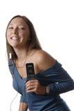 Uma menina com música foto de stock royalty free