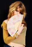 Uma menina com um ventilador Fotos de Stock
