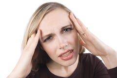 Uma menina com uma dor de cabeça imagens de stock