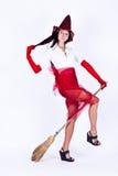 Uma menina com uma vassoura Fotografia de Stock