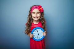 Uma menina da criança de cabelo da aparência de sete europeus Fotografia de Stock