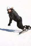 Uma menina da snowboarding Fotos de Stock