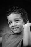 Uma menina de sorriso Fotografia de Stock Royalty Free