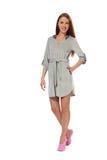 Uma menina em um bathrobe cinzento Fotografia de Stock Royalty Free