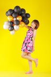 Uma menina feliz com balões Fotos de Stock Royalty Free