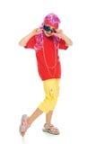 Uma menina na roupa extravagante e nos vidros 3d Fotografia de Stock Royalty Free