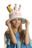 Uma menina no chapéu engraçado foto de stock