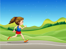 Uma menina que corre na rua perto dos montes Fotografia de Stock