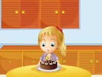 Uma menina que funde seu bolo Imagens de Stock Royalty Free