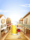 Uma menina que guardara uma cerveja na frente de um vidro grande da cerveja Foto de Stock
