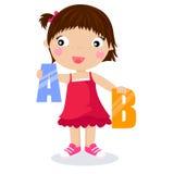 Uma menina que joga com letras Fotografia de Stock