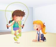 Uma menina que joga a corda de salto dentro da sala ilustração stock