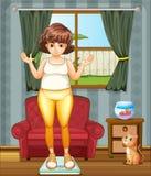 Uma menina que mede seu peso na escala de peso Imagens de Stock Royalty Free