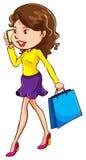 Uma menina que usa um telefone celular Fotos de Stock Royalty Free