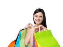 Uma moça feliz com os sacos de compras coloridos das lojas extravagantes Imagens de Stock Royalty Free