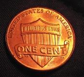 Uma moeda do centavo Foto de Stock
