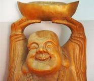 Uma monge chinesa de madeira de sorriso no santuário Imagens de Stock